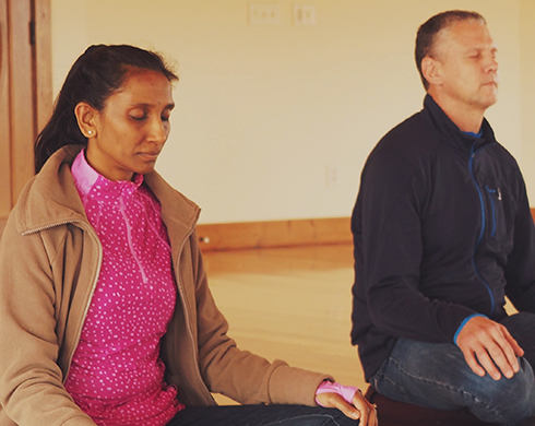 Woman and man meditating