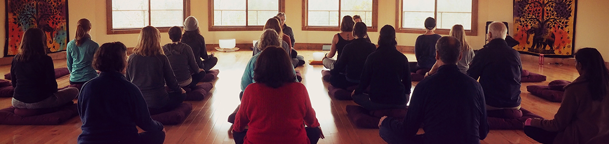 group of people meditating
