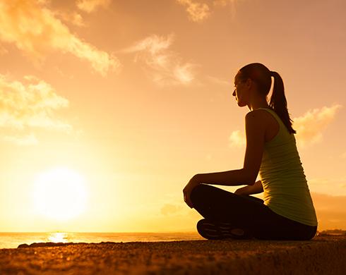 mindful woman greeting the sun
